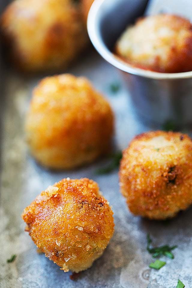 Close up of potato balls, deep-fried to golden brown.