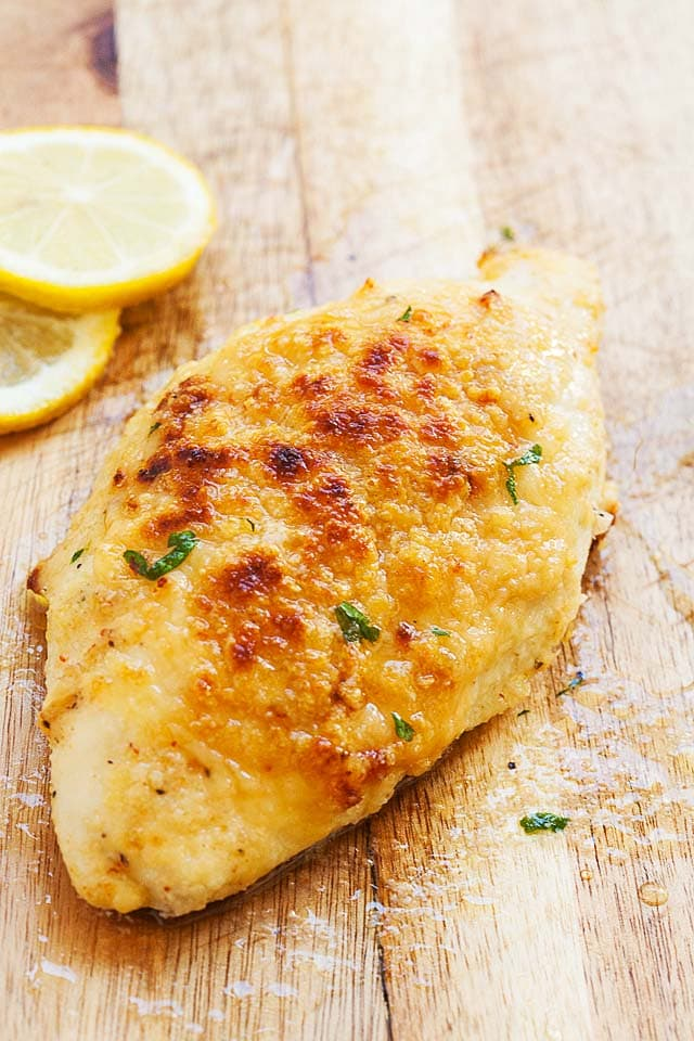 Easy oven baked chicken breast recipe served with a fork.