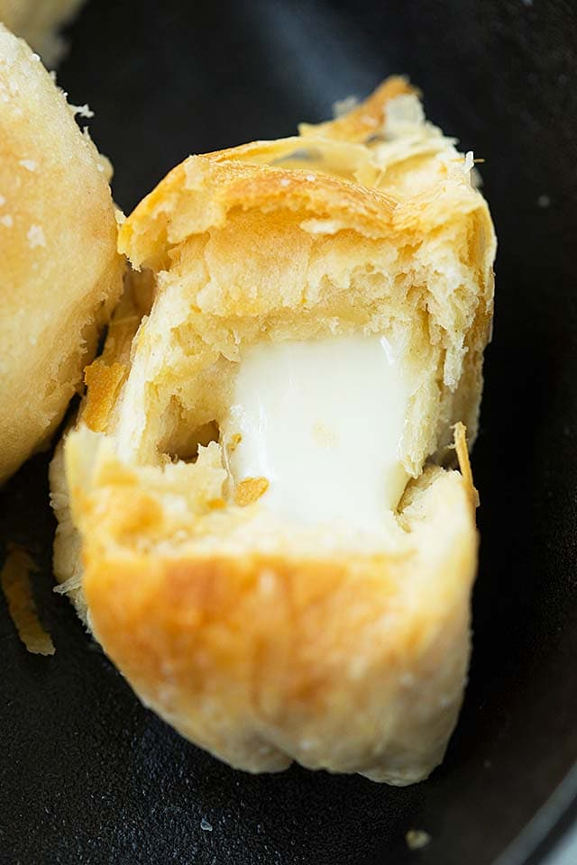 Close up picture of flaky melted cheese bombs.