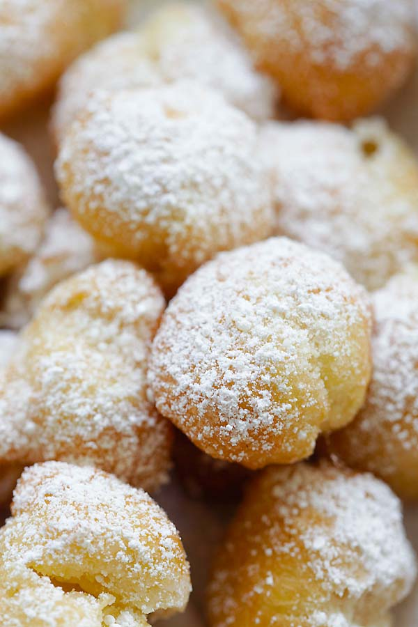 Homemade New Orleans beignets topped with sugar powder.