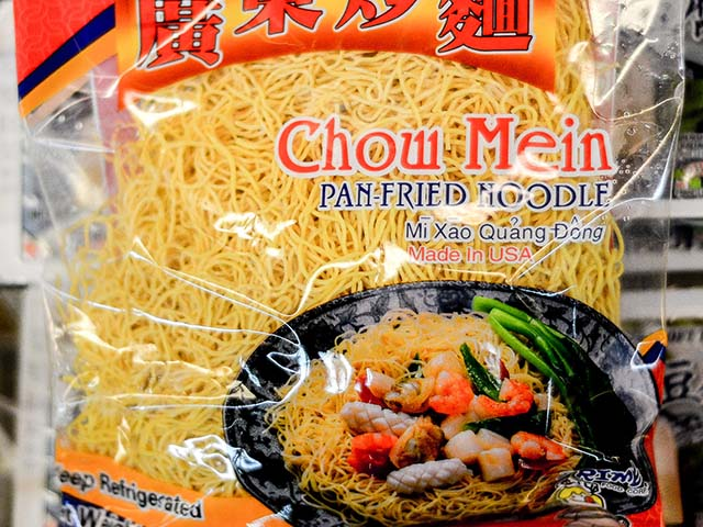 Fresh chow mein egg noodles in a clear plastic packaging.
