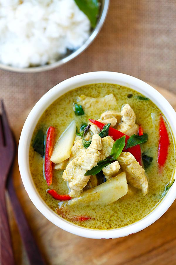 Top down view of green curry chicken with green curry sauce.