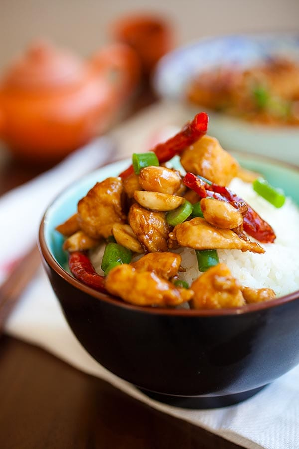 Chinese stir fry Kung Pao Chicken with dried red chilies, roasted peanuts in Kung Pao Sauce on top of steamed rice.
