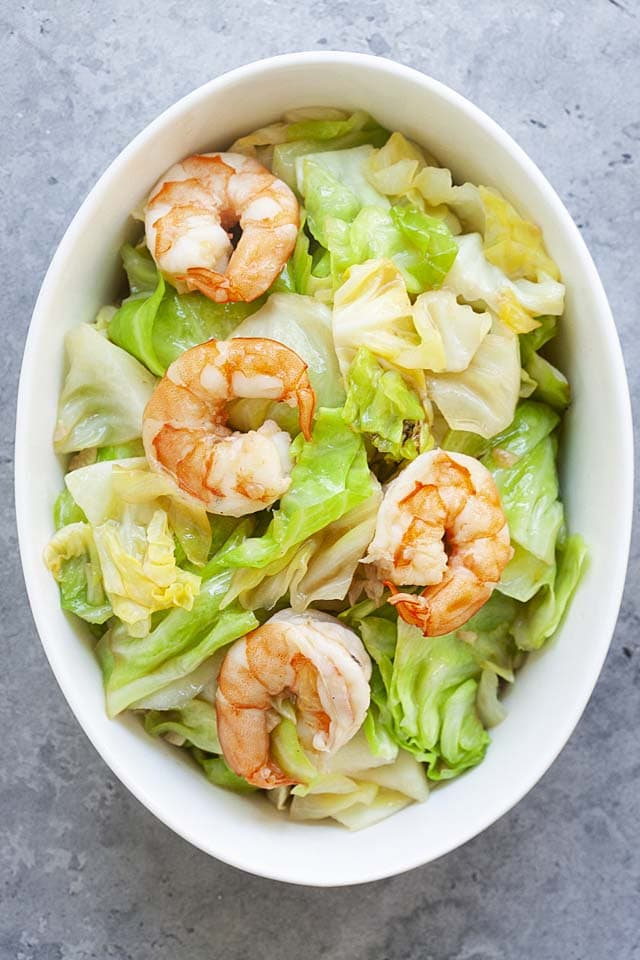 Cabbage sauteed with shrimp in a serving ware, ready to be eaten.