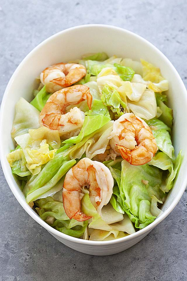 Cabbage recipe sauteed with shrimp, served in a white bowl.