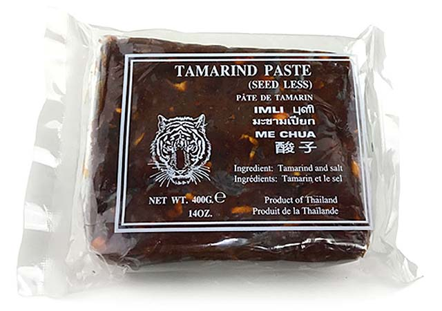 Pad Thai with tamarind is made with tamarind juice extracted from tamarind pulps. This is a picture of tamarind block in clear plastic packaging.