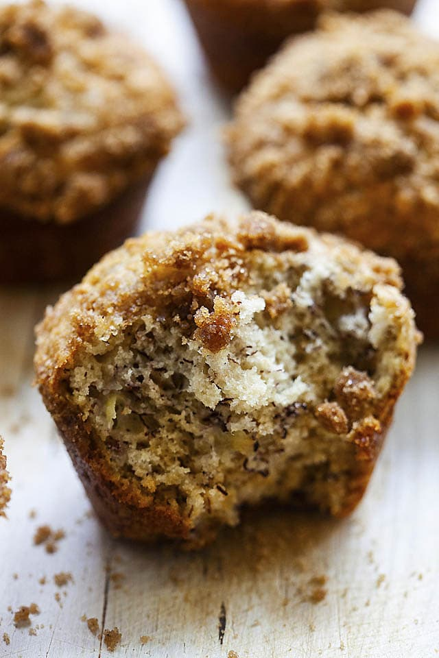 Inside of moist banana muffins with crunchy crumbs at the top of the muffins.