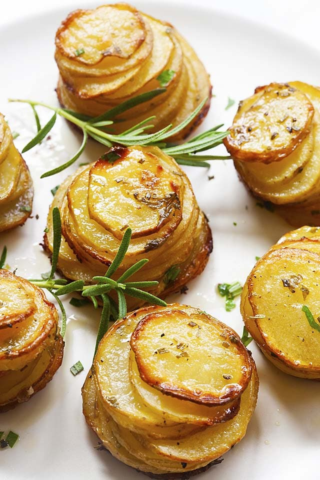 Oven baked potato stacks with herbs, ready to be eaten.