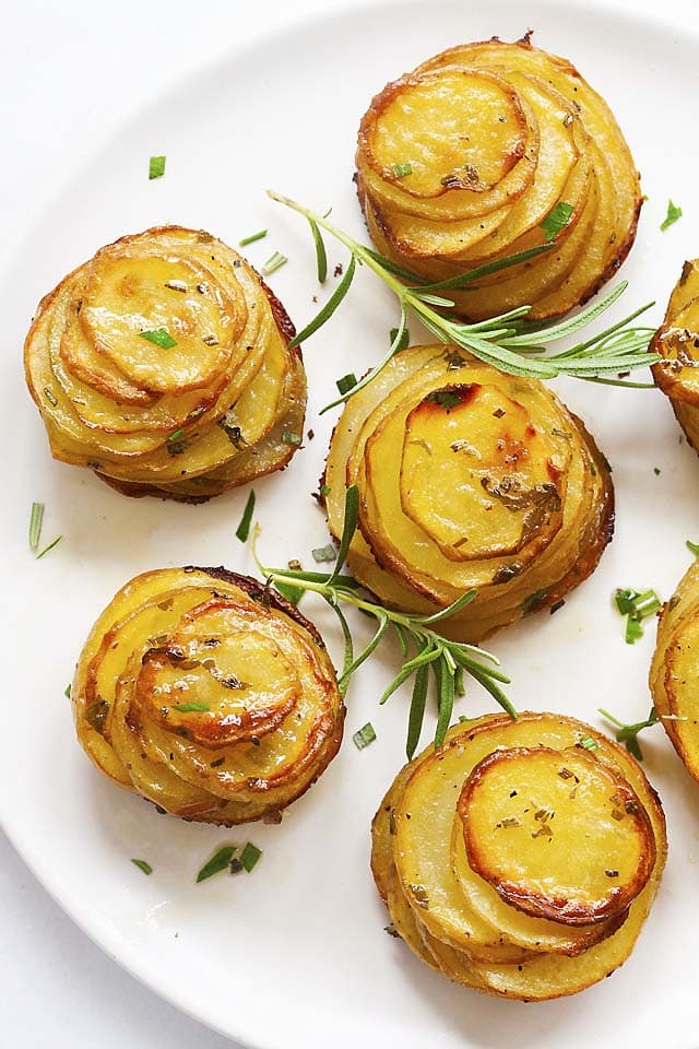 Top down picture of roasted potato stacks with rosemary herb.