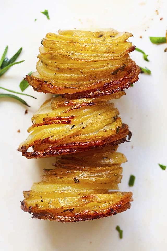 Close up of potato stacks with crispy tops and edges on the potatoes.