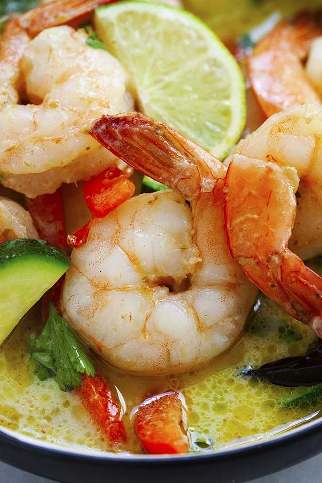 Close up shot of Thai shrimp curry in green curry sauce with vegetables.
