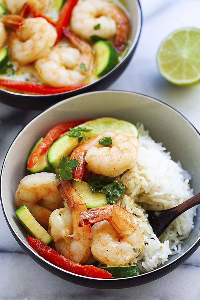 Shrimp curry with coconut milk, served with a bowl of rice.