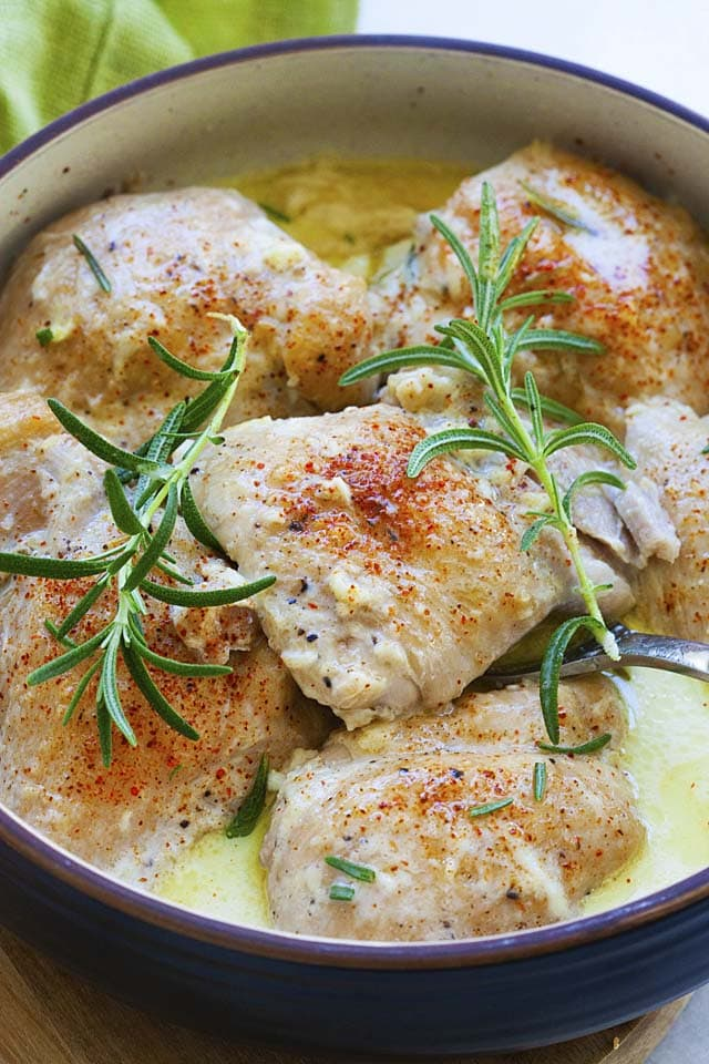 Instant pot creamy garlic chicken thighs topped with rosemary.
