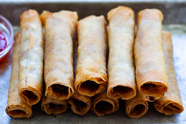 Lumpiang Shanghai with ground pork and vegetable filling, deep-fried and ready to serve.