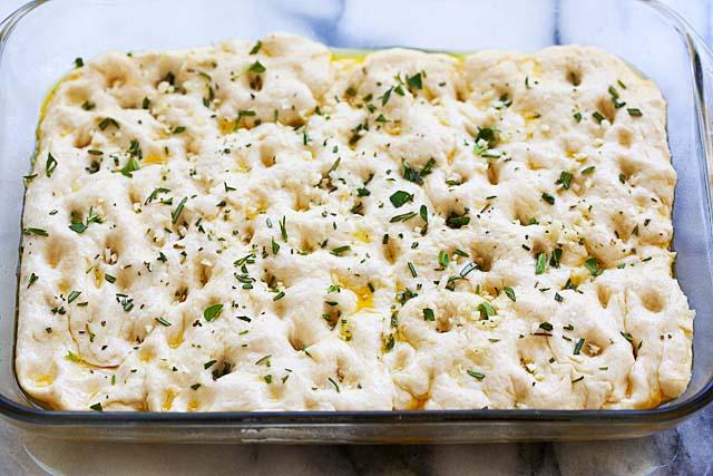 Add Focaccia toppings to Focaccia bread dough.
