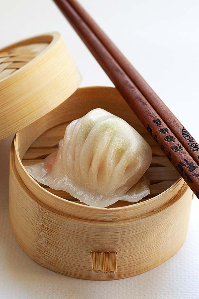 har gow in a bamboo steamer.