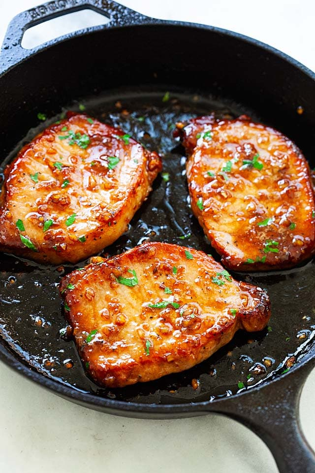 Boneless pork chops in a skillet.