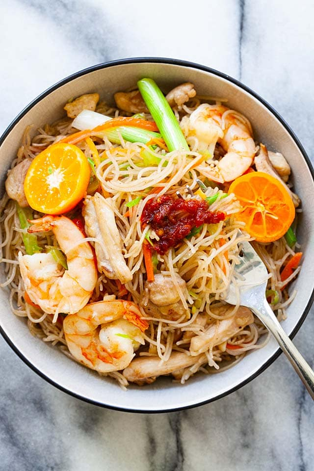 Pancit bihon is Filipino fried rice sticks or rice noodles, served in a bowl, ready to be eaten.
