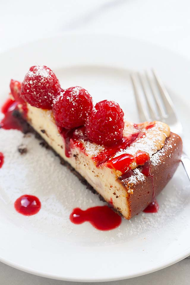 A slice of raspberry cheesecake just like Cheesecake Factory.