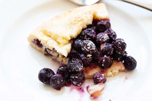 Blueberry lemon galette on a white plate.