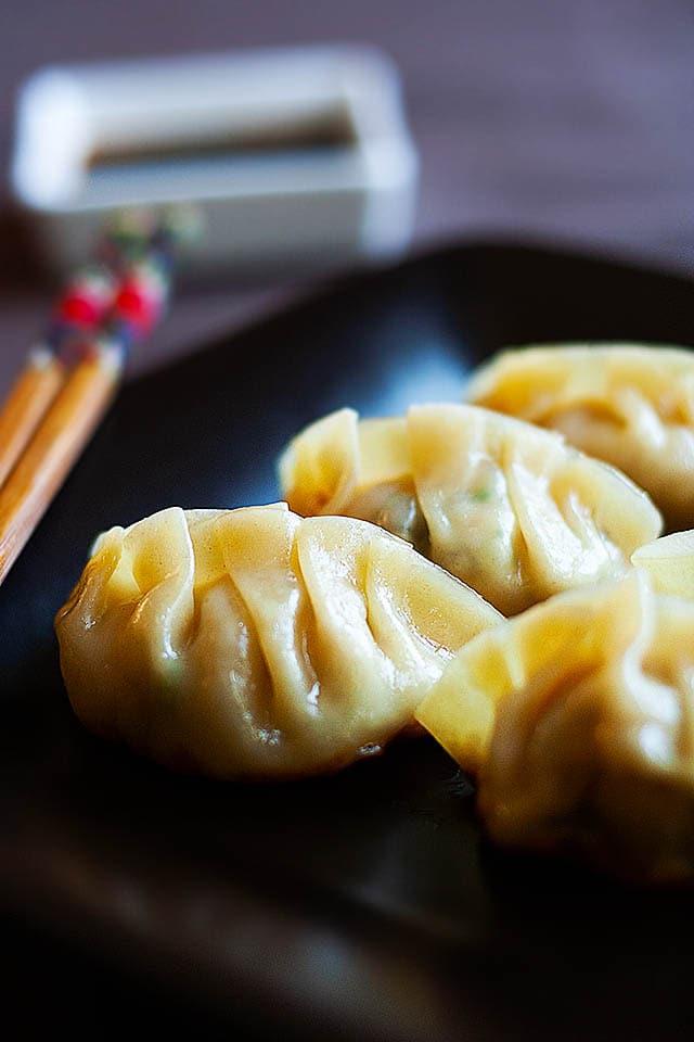Gyoza dumplings with gyoza sauce.
