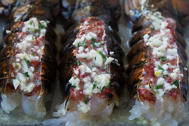How to cook lobster tail? Broil the tail in the oven with garlic butter and herb for 5-8 minutes.