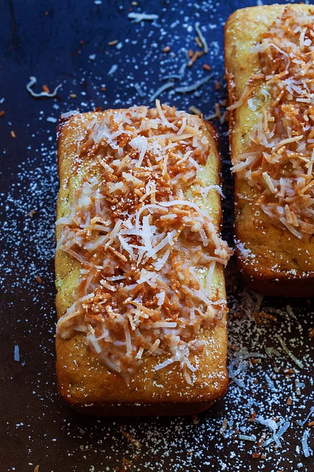 Loaf of Pina Colada quick bread with toasted coconut on top.
