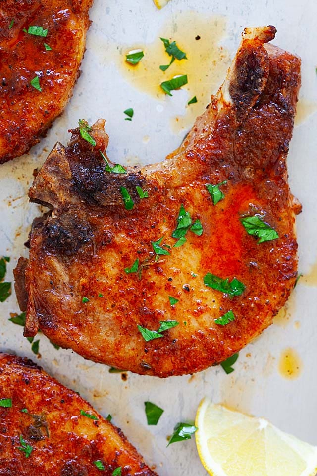 Tender and marinated baked pork chops bone in.