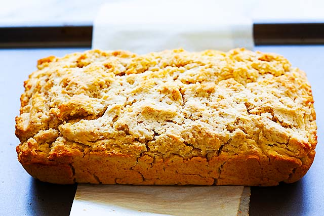 Easy beer bread made with beer bread mix of flour, melted butter, sugar and beer.