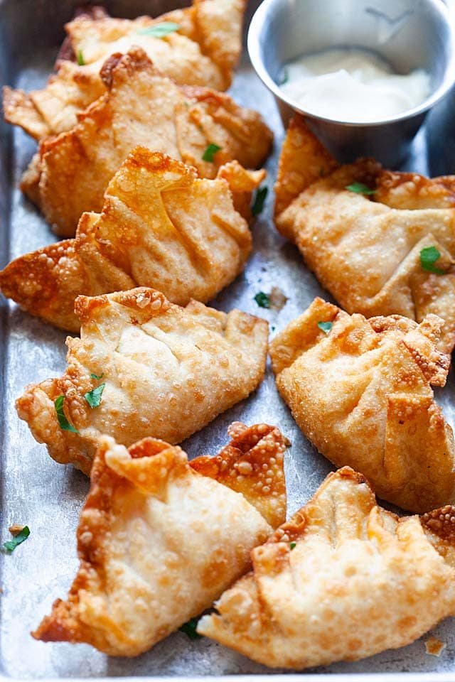 Shrimp wontons deep-fried to crispy goodness, on a serving tray.