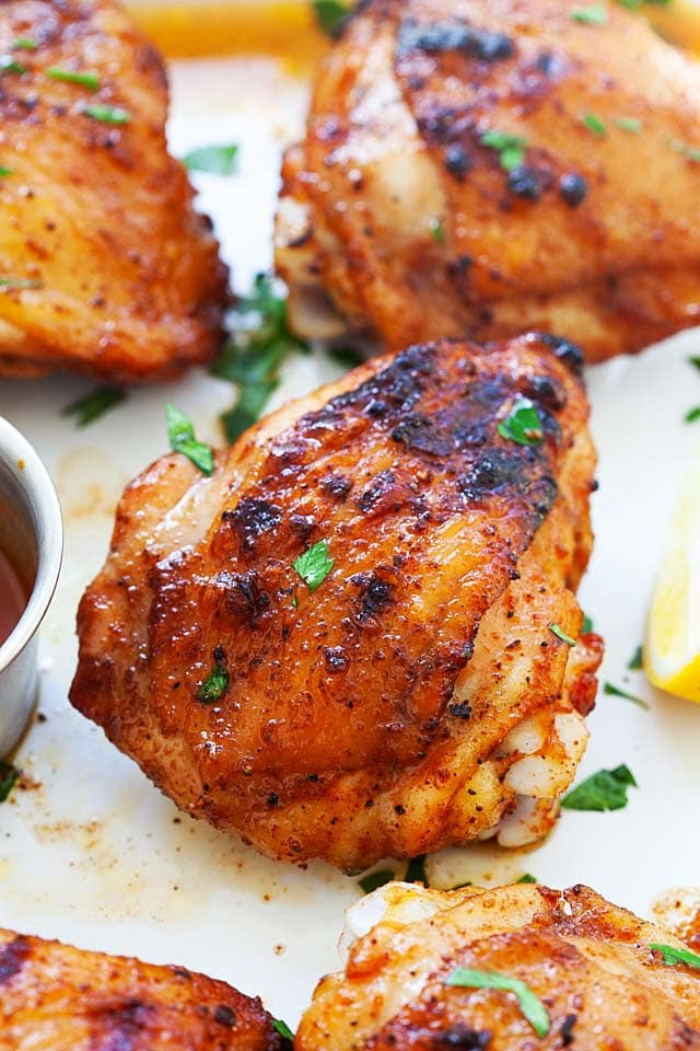 BBQ chicken thighs with perfectly charred and crispy skin.
