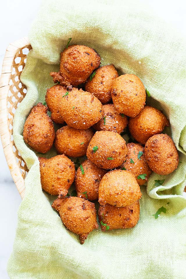 Hush puppies in a serving tray with spicy mayonnaise dipping sauce.