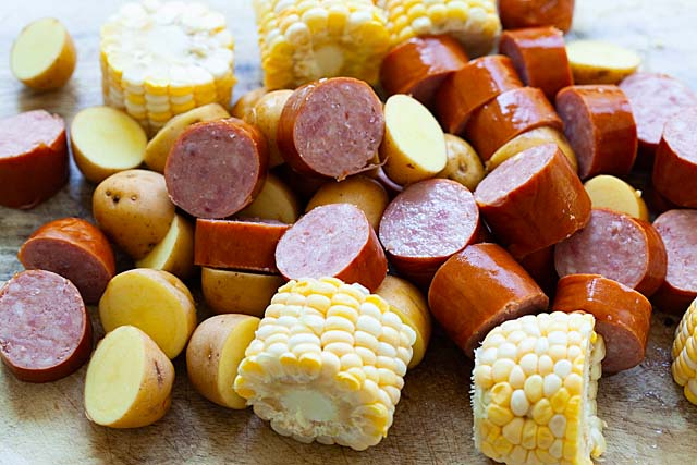 Shrimp boil ingredients: potatoes, smoked sausage and corn, ready to boil with shrimp.