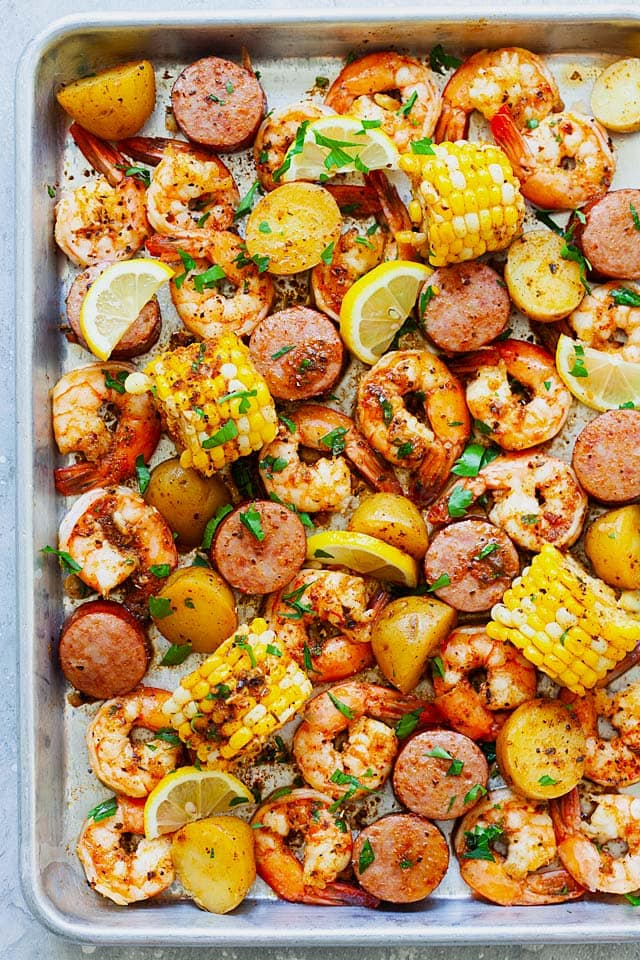 Shrimp boil recipe with old bay, shrimp, potatoes, corn and smoked sausages in shrimp boil Cajun seasoning.