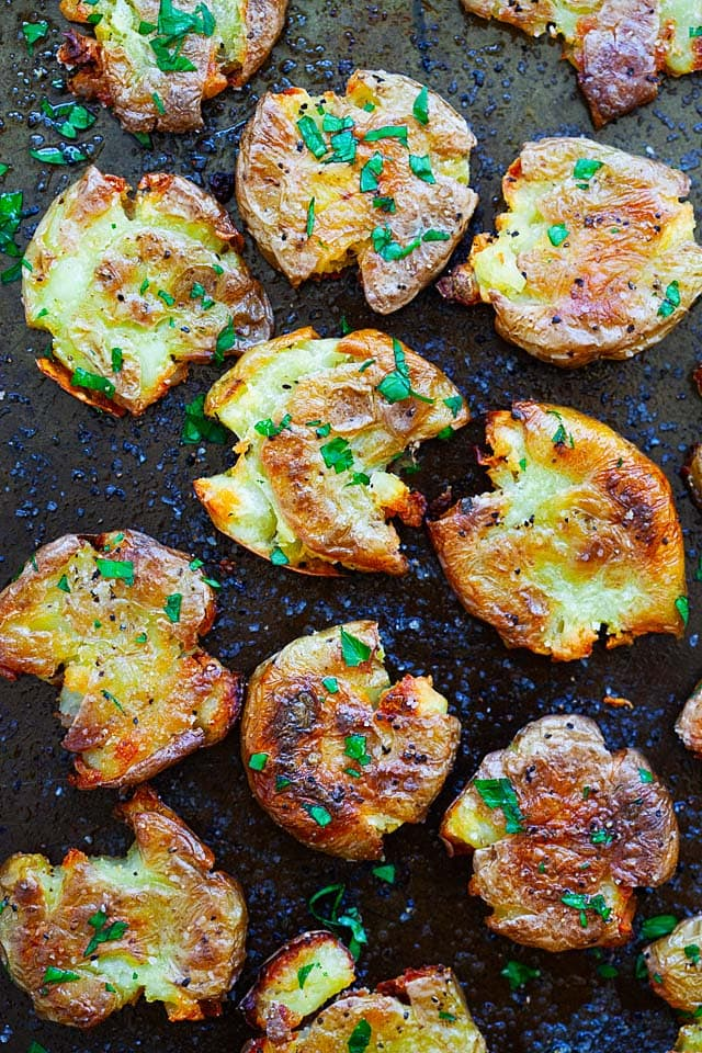 Smashed potatoes on a baking sheet.