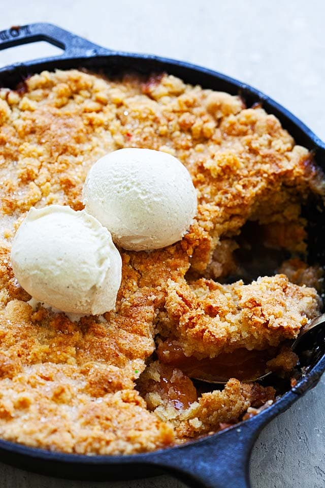 Peach cobbler pie baked in a cast-iron skillet.