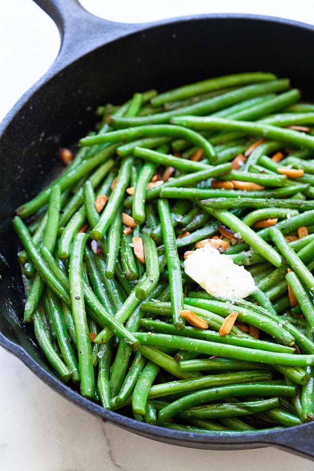 Green bean recipe sauteed on a skillet with brown butter.