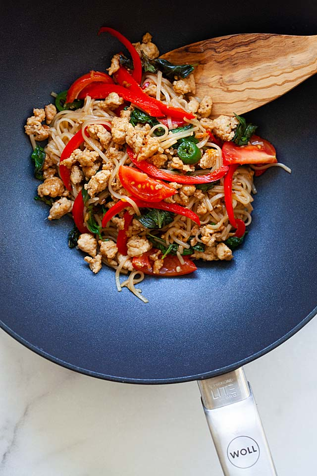 Drunken noodles in a wok.