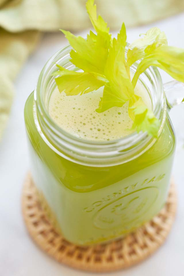 Close up shot of celery juice in a glass.