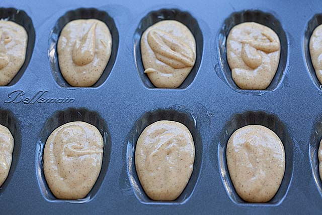 Madeleine batter in a madeleine mold pan.