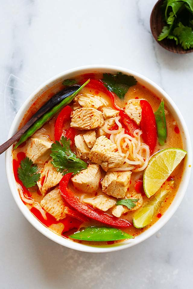 Thai chicken noodles soup in a serving bowl.