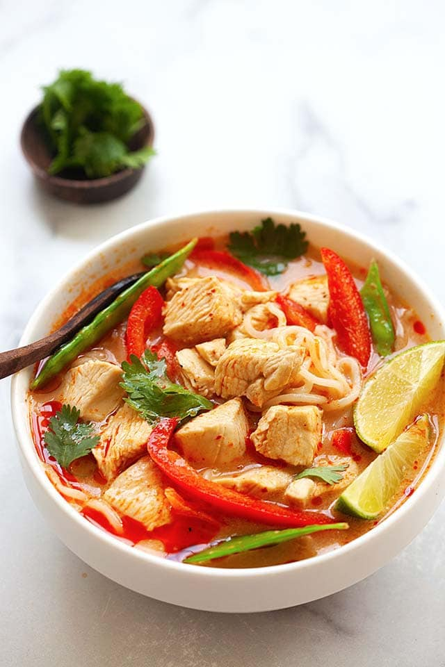 Coconut chicken noodle soup with Thai spices and broth.