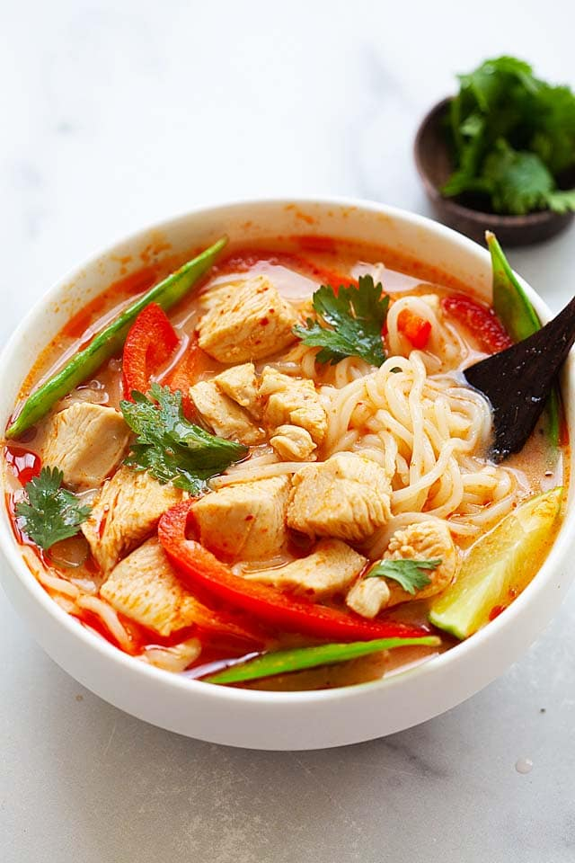 Thai noodle soup broth recipe with chicken, red curry paste and coconut milk.