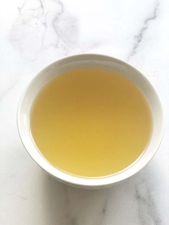 A bowl of clear dashi broth or dashi stock made with an easy dashi recipe of only 3 ingredients.