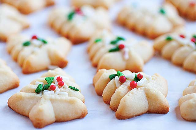 Spritz cookie recipe with Christmas tree shape and sprinkles.