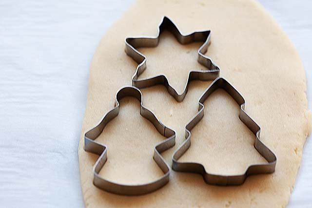 Cut out Christmas sugar cookies.