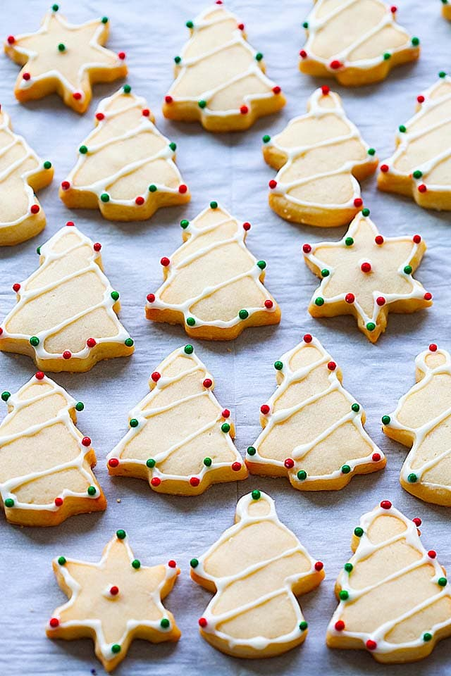 Easy and best sugar cookie recipe with Christmas sugar cookies cut out from the cookie dough.