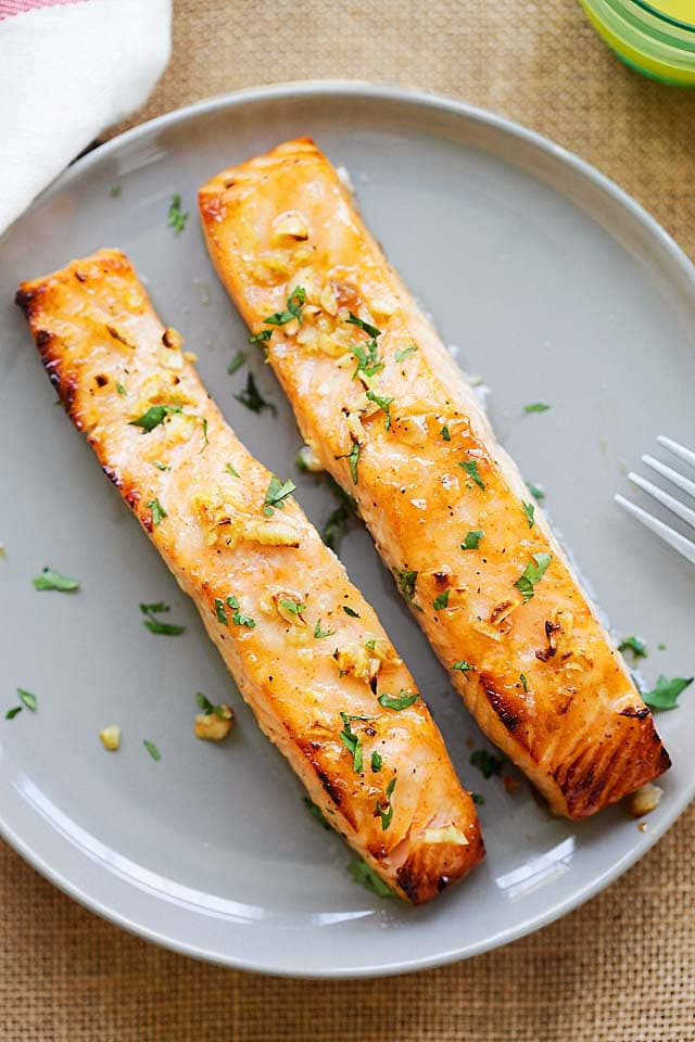 Oven baked salmon served on a plate.