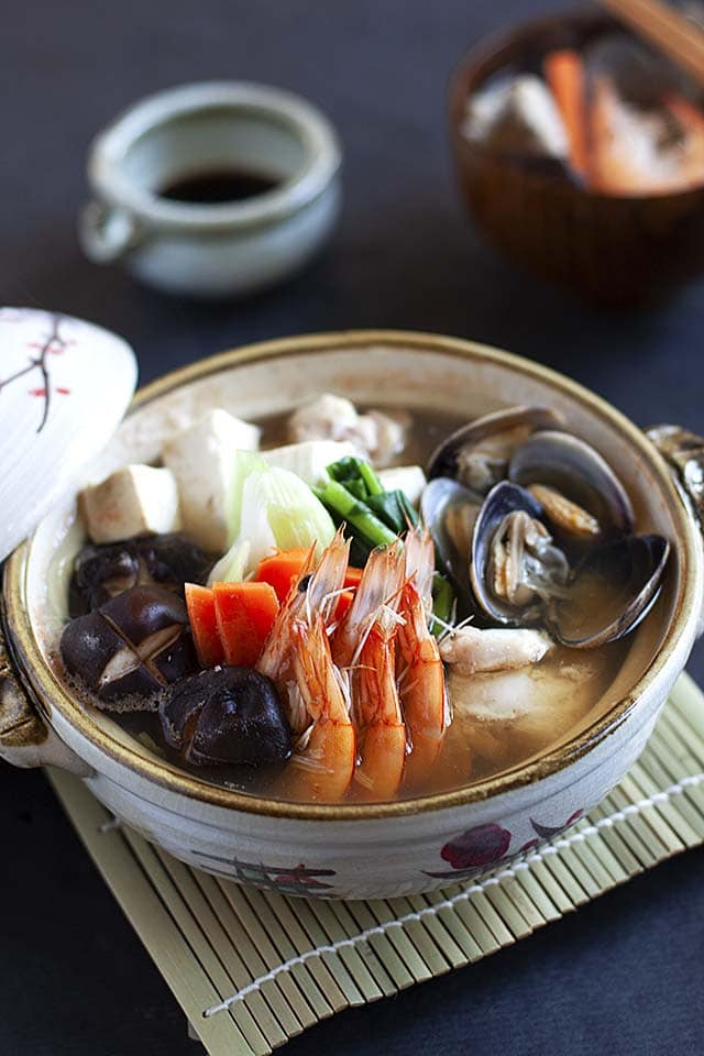 Nabe hot pot with tofu, chicken, fish, shrimp and vegetables.
