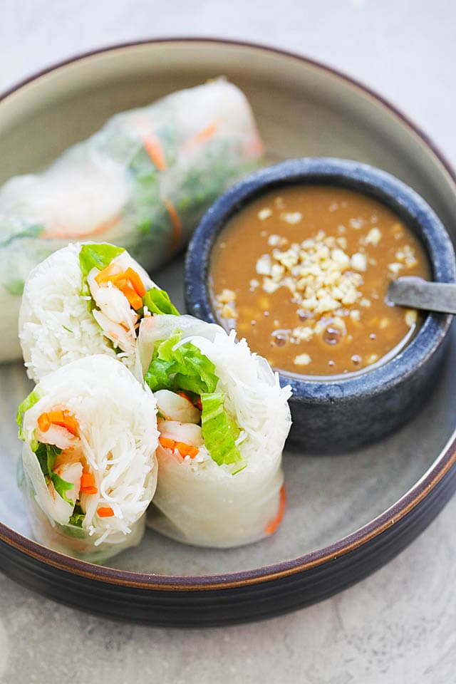 Shrimp summer rolls served with a side of hoisin-peanut dressing sauce.